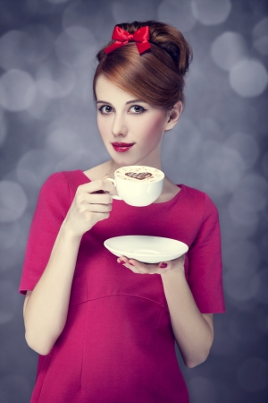 Redhead girl with coffee cup. St. Valentine Day. Stock Photo - 17130148