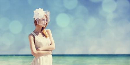 wedding veil: Young bride at the beach.