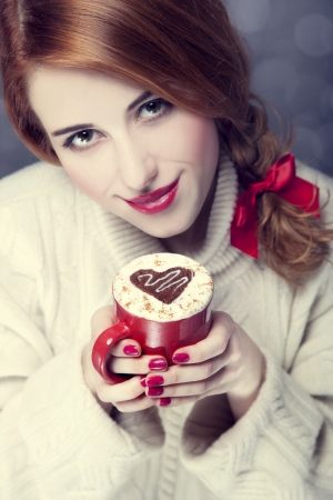 Redhead girl with red coffee cup at. St. Valentine's Day Stock Photo - 17147995