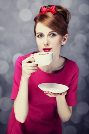 leisure time: Redhead girl with coffee cup. St. Valentines Day.