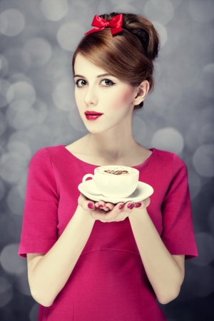 Redhead girl with coffee cup. St. Valentine's Day. Stock Photo - 17148010