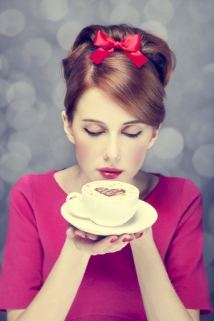 Redhead girl with coffee cup. St. Valentine's Day. Stock Photo - 17147999
