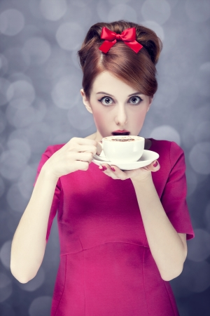 Redhead girl with coffee cup. St. Valentine Day. Stock Photo - 17147459
