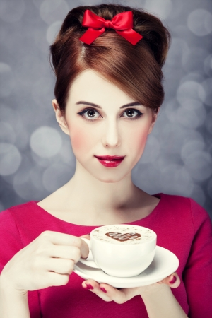 Redhead girl with coffee cup. St. Valentine Day. Stock Photo - 17147461