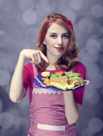 Redhead women with cookies Stock Photo - 17266236