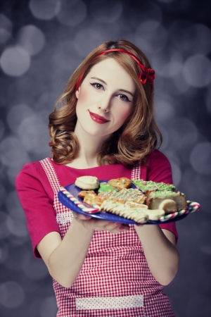 Redhead women with cookies Stock Photo - 17266239