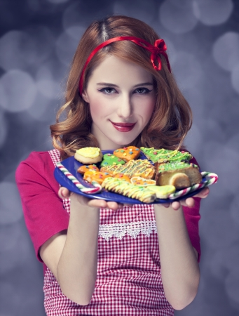 Redhead women with cookies Stock Photo - 17266212