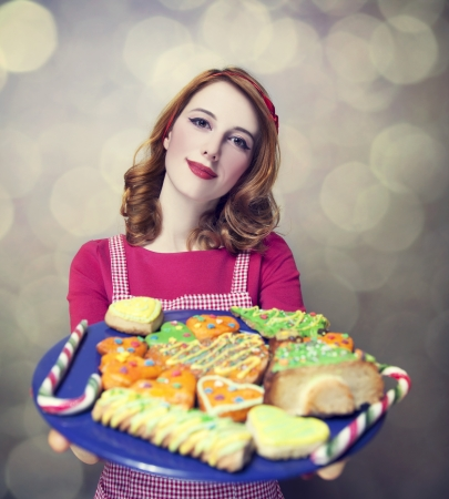 Redhead women with cookies Stock Photo - 17266201