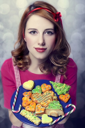 Redhead women with cookies Stock Photo - 17266235
