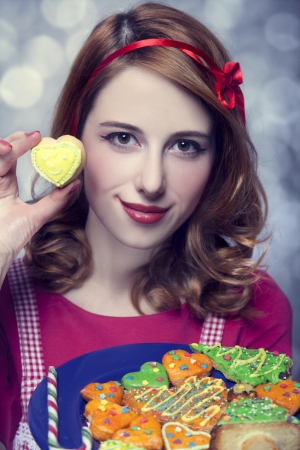 Redhead women with cookies Stock Photo - 17266226