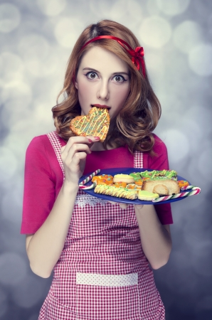 Redhead women with cookies Stock Photo - 17266227