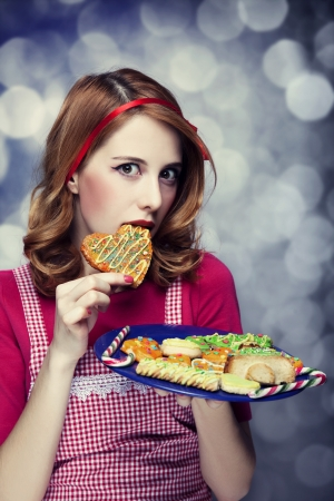 Redhead women with cookies Stock Photo - 17266237