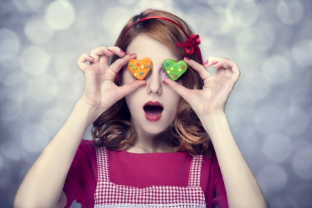 Redhead women with cookies Stock Photo - 17266225