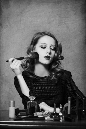 Woman applying cosmetics Stock Photo - 17266234