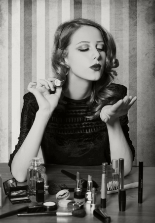 Woman applying cosmetics Stock Photo - 17266222