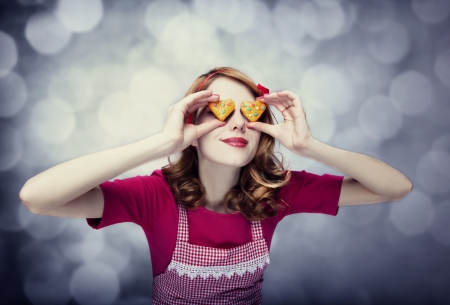 Redhead women with cookies Stock Photo - 17333265