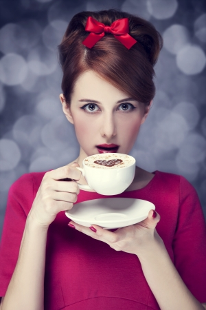 Redhead girl with coffee cup. St. Valentine's Day. Stock Photo - 17333269
