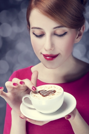 Redhead girl with coffee cup. St. Valentine's Day. Stock Photo - 17333266
