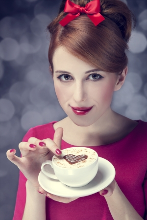 Redhead girl with coffee cup. St. Valentine's Day. Stock Photo - 17333267