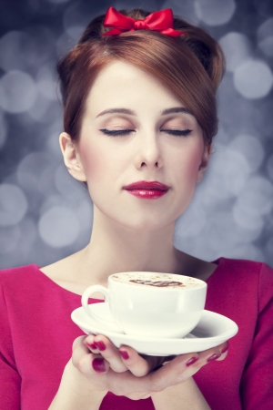 Redhead girl with coffee cup. St. Valentine's Day. Stock Photo - 17333271
