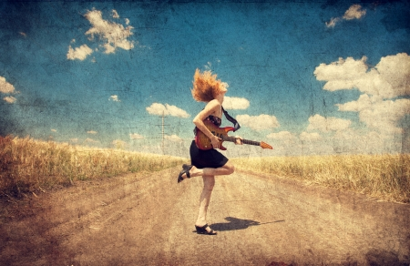 rock   roll: Red-head girl with guitar. Photo in old image style. Stock Photo