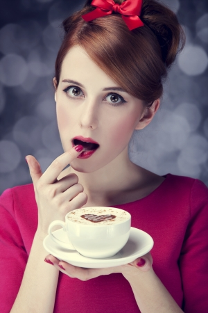 Redhead girl with cup of coffee for St. Valentine's Day. Stock Photo - 17602608