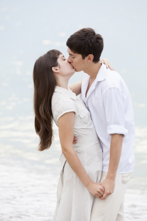 Couple kissing at the beach Stock Photo - 17542682