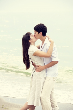Couple kissing at the beach Stock Photo - 17542672
