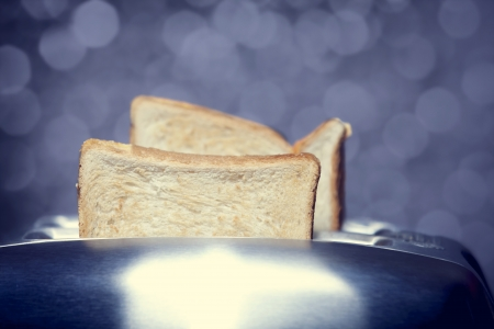 Close-up shot of a bread toast in a toaster photo
