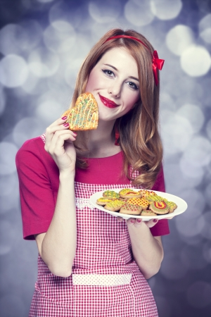 Redhead women with cookie Stock Photo - 17602527