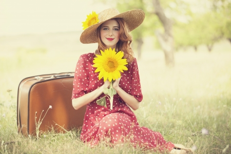 Redhead girl with sunflower at outdoor. Stock Photo - 17602637