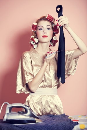 Housewife with iron and curler photo
