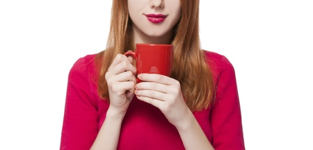 Red-haired girl with cup. Stock Photo - 17657490