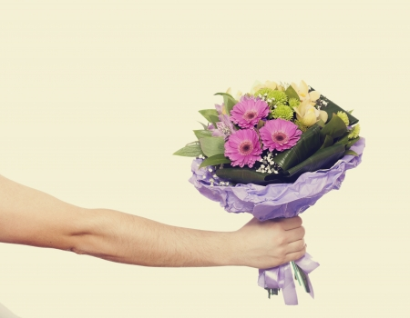 hand with a flowers isolated on white photo