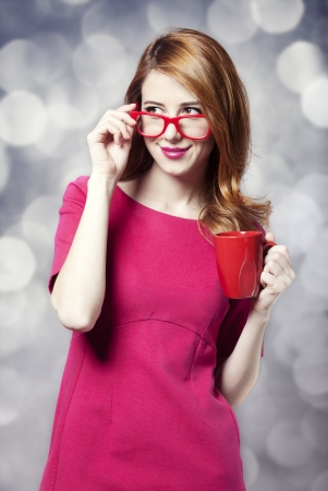 Redhead girl with red cup. Stock Photo - 18184721