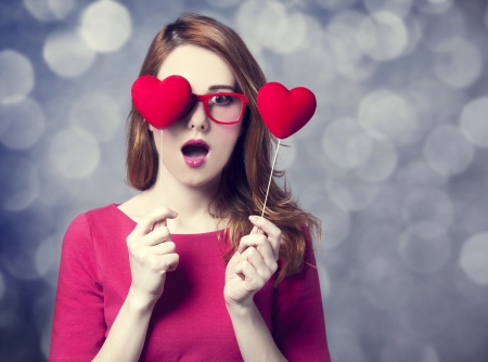Beautiful redhead girl with two hearts.  Stock Photo