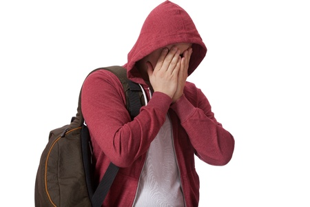 hooded top: Young sad teenage boy isolated on white background