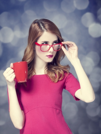 Redhead girl with red cup. Stock Photo - 18183670