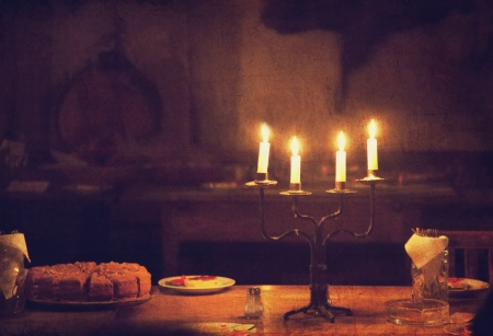 candle light: Retro candle and cake on table. Photo in old vintage style.