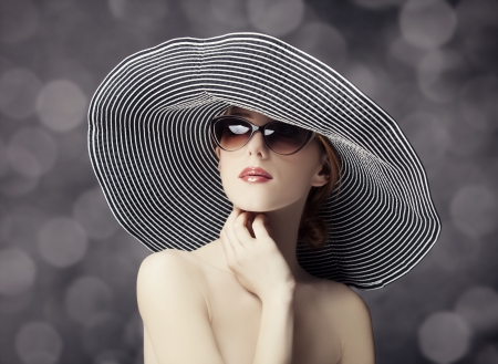 Fashion women in wide hat photo
