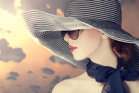 Fashion women in wide hat at sunrise photo