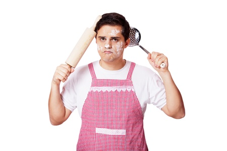 fireproof: Cooking man with kitchenware over white background Stock Photo
