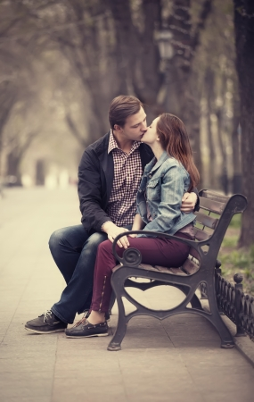 Young couple kissing on the street photo
