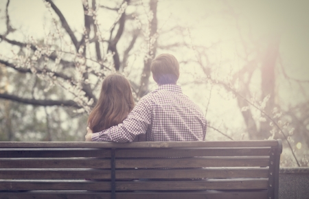 Young couple on the bench at the street. Stock Photo - 19203670