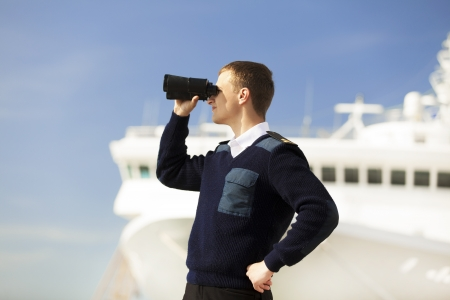 captain ship: boatswain near the boat Stock Photo