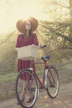 Girl on a bike in the countryside in sunrise time. photo