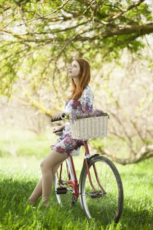 Girl on a bike in the countryside photo