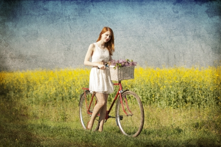 Girl on a bike in the countryside. Stock Photo - 19583688