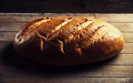 appease: Delicious bread on a wood table