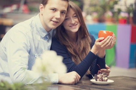 sweet seventeen: young couple in the cafe.